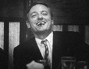 William F Buckley Holding Book Somewhat Reasonable
